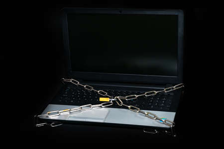 Laptop pc with chain and padlock symbol of internet security. High quality photo
