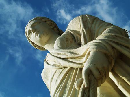 singular architecture: Antique statue and blue sky