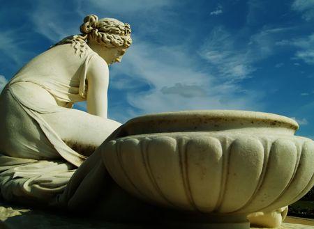 singular architecture: Woman and pot Stock Photo