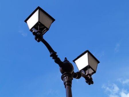singular architecture: Lamp over blue sky Stock Photo
