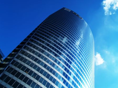 workspaces: Office building over blue sky Stock Photo