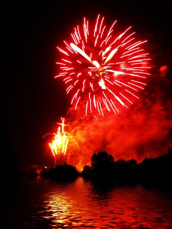 fiestas: Fireworks and reflection on water