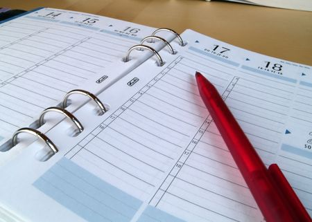 workspaces: Appointment book with swallow DOF Stock Photo