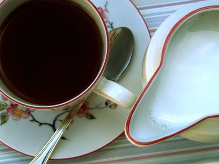 Cup of tea with milk Stock Photo - 514016