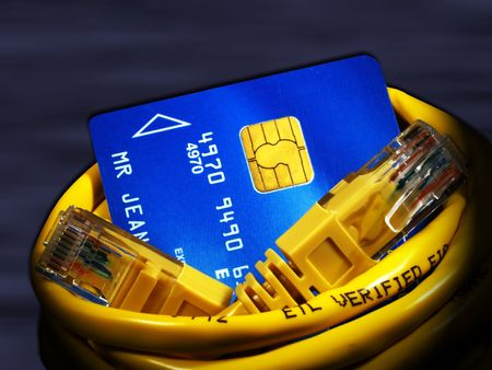 purchasers: Close up of a credit card and a network cable