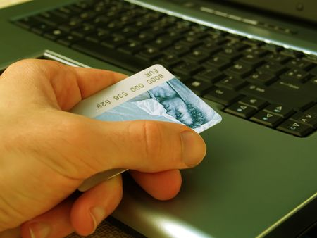 purchasers: Hand, credit card, and laptop Stock Photo