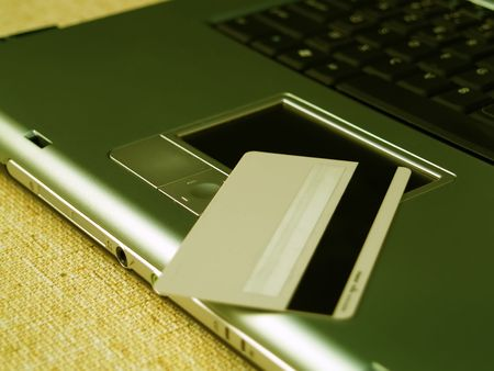 purchasers: Close up of a credit card and a laptop Stock Photo