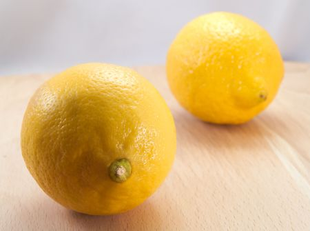 Two lemons on a table photo