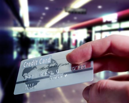 purchasing: Purchasing with a credit card in a shopping mall
