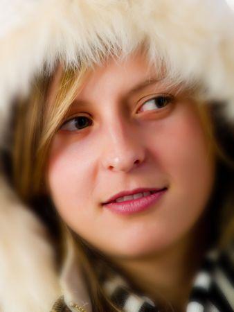 wintersport: Cute girl wearing a white coat in winter