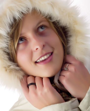 wintersport: Cute girl wearing a white coat in winter