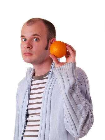 Young amazed man holding an orange photo