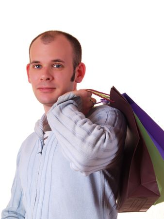 Young good looking man holding some shopping bags photo