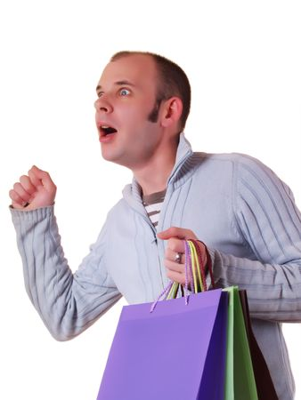 good looking man: Young good looking man holding some shopping bags Stock Photo