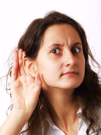 Girl listening with her hand on an ear photo