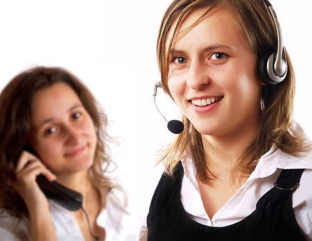 Two young customer representatives in a call center photo