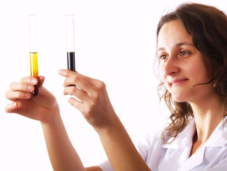 Scientist looking at a test tube in a laboratory photo