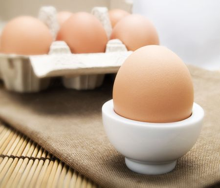 eggcup: Egg in a white eggcup Stock Photo