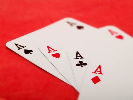red bluff: Playing cards on a red background Stock Photo