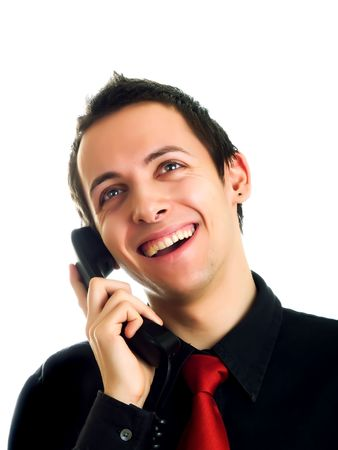 Young man having a phone call photo