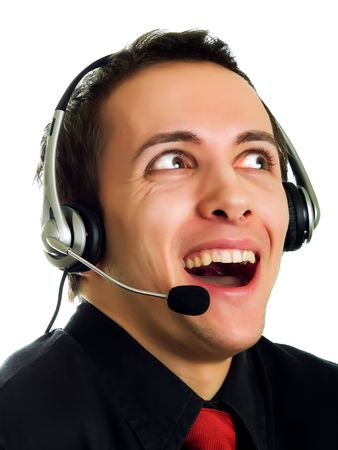 Young man calling with a haeadset and laughing photo