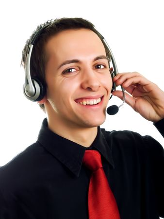 Young man calling with a haeadset and smiling photo