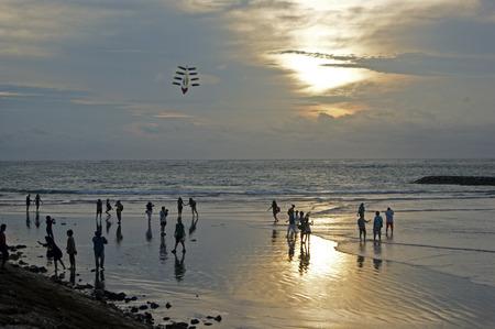 kuta: People in Kuta beach during sunset Stock Photo