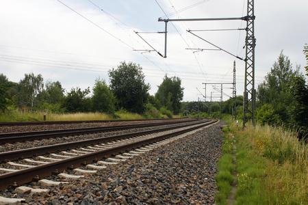 railtrack: iron rusty train railway detail dark stones Stock Photo
