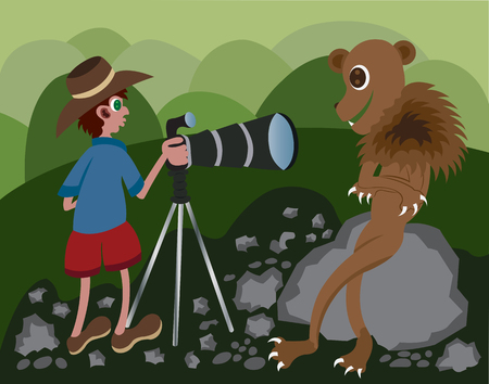 A wildlife photographer taking photo of a lion