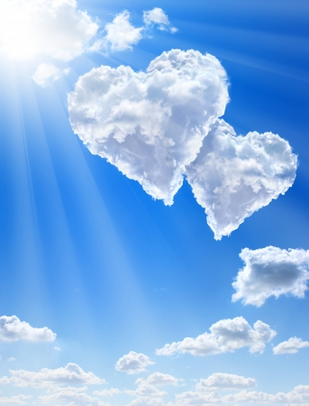 cupids: Hearts in clouds against a blue clean sky