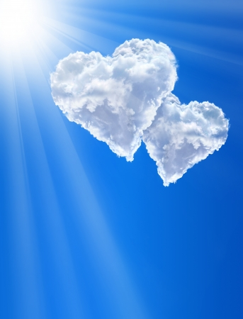 Hearts in clouds against a blue clean sky Stock Photo - 14692166