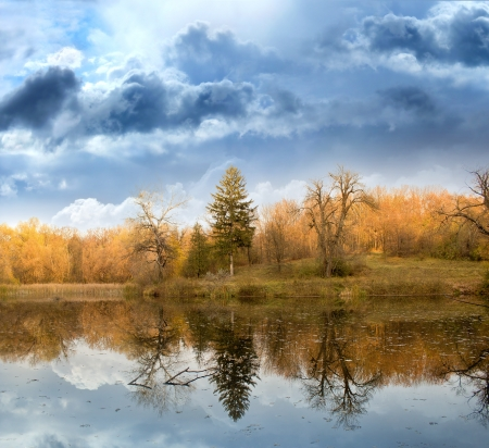 Autumn landscape against the terrible sky and the river Stock Photo - 14692196