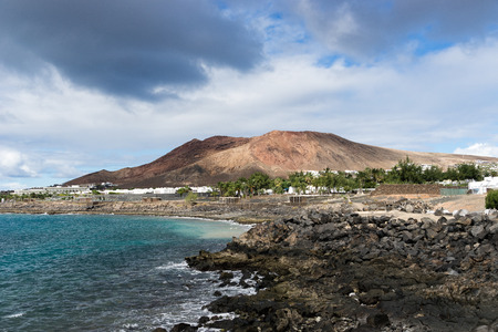 islas: The Red Mountain as it is also called by visitors of the island. Between the volcano and the sea are a string of resorts and they all are a part of Playa Blanca.