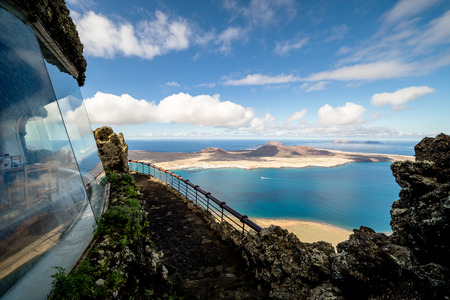 islas: Mirador del Rio is a viewpoint situated on an Approximately 475 meters high escarpment called Bateria del Rio in the very north of the Canarian island of Lanzarote.The location was created in 1974 by the local artist Cesar Manrique. Mirador of the Rio bie Stock Photo