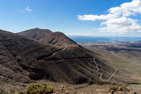 islas: Hacha Grande is a mountain on the Canary Island of Lanzarote, with an elevation of 562 m 1844 ft above sea level. Its name is Spanish meaning Large Axe. Stock Photo