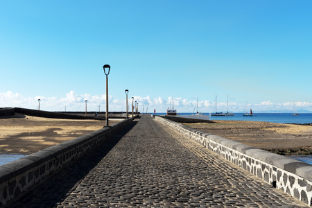 islet: One of two causeways leading to Islet of the English, Arrecife.Situated on this islet is the Castle of San Gabriel.