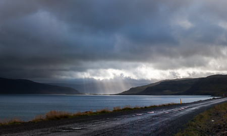 clouds making: At the very end of Patreksfjordur the sun broke through the clouds making a great show.