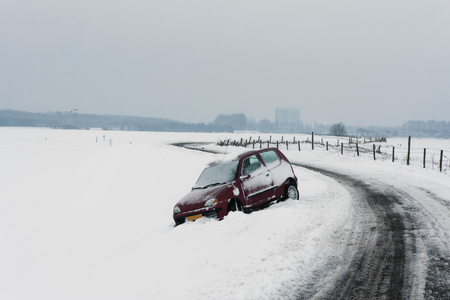 extreme weather: Car went off the road in extreme weather. Stock Photo