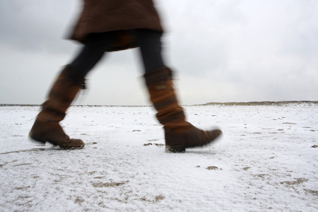 white winter: Winter walk on a completely white beach in mid winter in the Netherlands