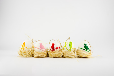 raffia: Hand painted Easter Eggs in a raffia nest.