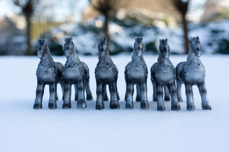 meant: Silver horses in the snow, meant for decoration during holidays