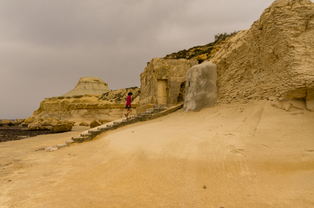 great bay: Xwejni bay in Gozo, a great place for  a swim or a walk Stock Photo