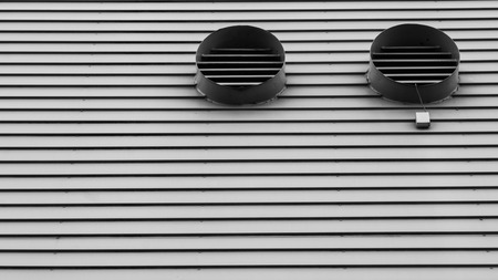 noord: lines and patterns at a building in the harbor of Amsterdam, the Netherlands Stock Photo