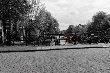 noord: Black and white image of a canal in Amsterdam