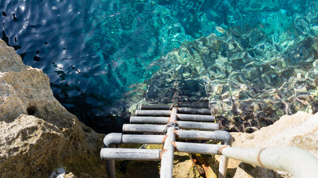 crystal clear: crystal clear sea with stairs for easy access Stock Photo
