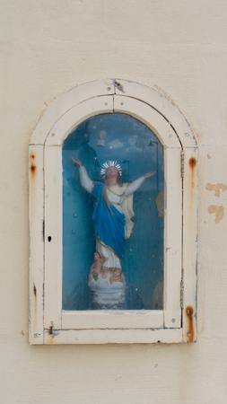 esteemed: holy niches (street shrines) bearing the statues of esteemed saints in Gozo's towns and villages Stock Photo