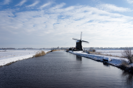 noord: Winter landscape with the ever so typical Dutch windmill