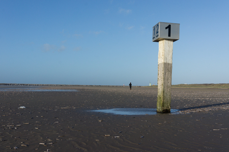 nederland: The North Sea Coast of The Netherlands is in its full lengths completely marked with beach posts