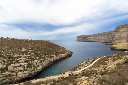 Small inlet next to Xlendi bay with the Xlendi tower at the horizon