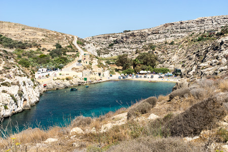 snorkelling: The Mgarr Ix-Xini beach has beautiful waters and great snorkelling and diving Stock Photo